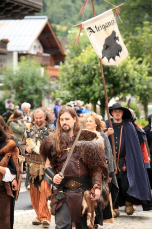 carying: KAPRUN, AUSTRIA - JUL 22: The Castle festival on July 22, 2012, in Kaprun, Austria a Traditional annual festival in a region of The Alps Mountains.