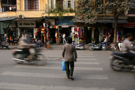 People Crossing Street in the Busy Streets of Hanoi, Vietnam