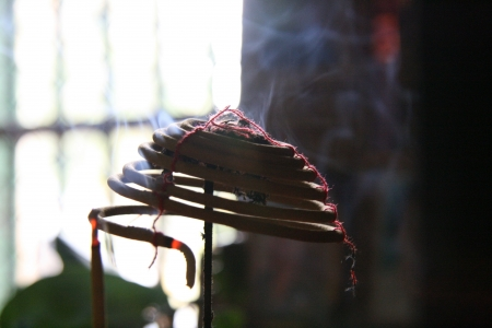 Incense Burning at Giac Lam Pagoda in Vietnam Stock Photo - 15514656