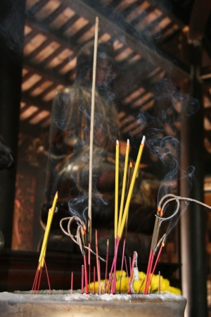 Incense Burning at Giac Lam Pagoda in Vietnam photo