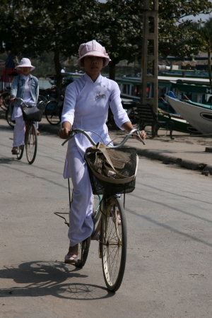 Riding Bike in Hoi An City in Central Vietnam Stock Photo - 15371230