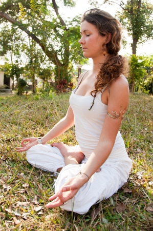 Yoga female master in lotus posture photo