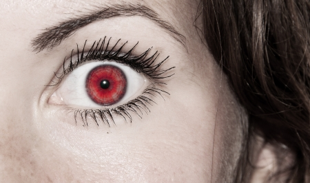 Beautiful Red Feminine Eye Closeup of a Woman photo