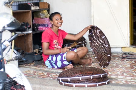 Girl Making Basket in Penang City in Malaysia