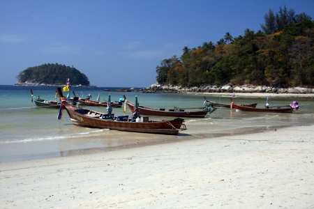long tailed boat: Phuket - A popular travel destination in Southern Thailand Editorial