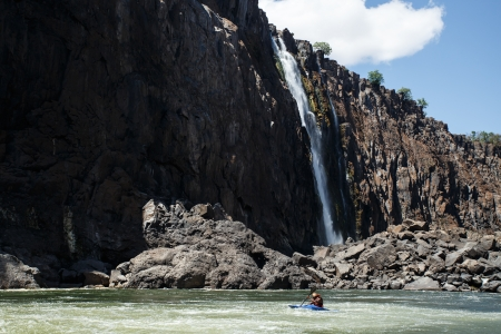 Extreme kayaker attempts the mighty Zambezi river rapids in Livingstone, Zambia, Africa photo