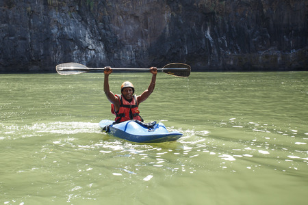 kayaker: LIVINGSTONE - OCTOBER 01 2013: Extreme kayaker gets ready to attempt the mighty Zambezi river rapids in Livingstone, Zambia, Africa