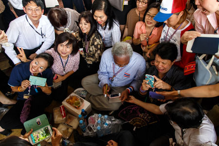 BANGKOK - APRIL 3 2014: Leader Suthep Meets supporters and signs autograph for protesters near Rama 8 Bridge in Bangkok, Thailand Stock Photo - 27171595