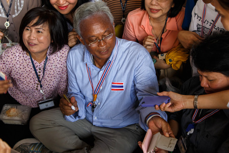 BANGKOK - APRIL 3 2014: Leader Suthep Meets supporters and signs autograph for protesters near Rama 8 Bridge in Bangkok, Thailand Stock Photo - 27171596
