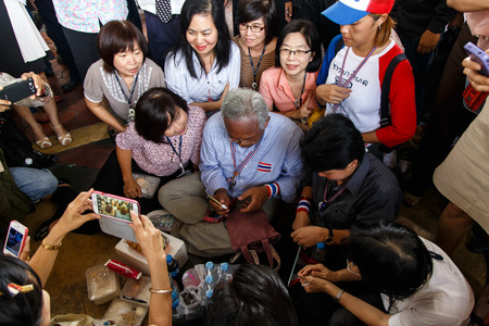 BANGKOK - APRIL 3 2014: Leader Suthep Meets supporters and signs autograph for protesters near Rama 8 Bridge in Bangkok, Thailand Stock Photo - 27171598