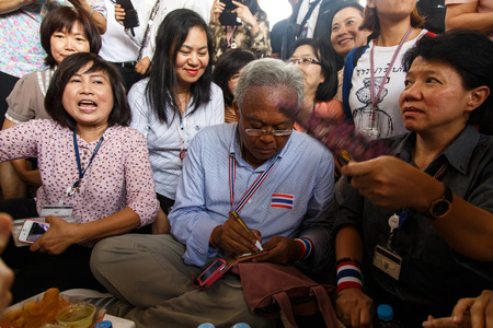 BANGKOK - APRIL 3 2014: Leader Suthep Meets supporters and signs autograph for protesters near Rama 8 Bridge in Bangkok, Thailand Stock Photo - 27171599