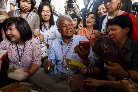 BANGKOK - APRIL 3 2014: Leader Suthep Meets supporters and signs autograph for protesters near Rama 8 Bridge in Bangkok, Thailand Stock Photo - 27171600