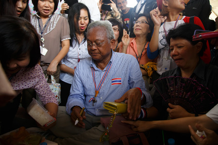 BANGKOK - APRIL 3 2014: Leader Suthep Meets supporters and signs autograph for protesters near Rama 8 Bridge in Bangkok, Thailand Stock Photo - 27171601