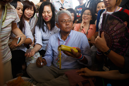 BANGKOK - APRIL 3 2014: Leader Suthep Meets supporters and signs autograph for protesters near Rama 8 Bridge in Bangkok, Thailand Stock Photo - 27171602