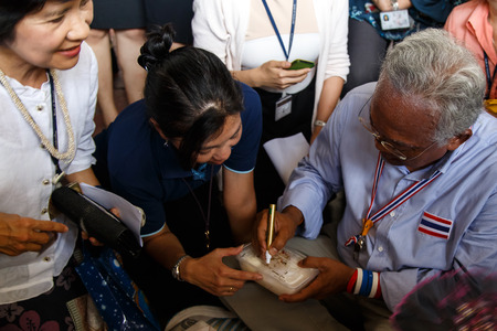 BANGKOK - APRIL 3 2014: Leader Suthep Meets supporters and signs autograph for protesters near Rama 8 Bridge in Bangkok, Thailand Stock Photo - 27171605