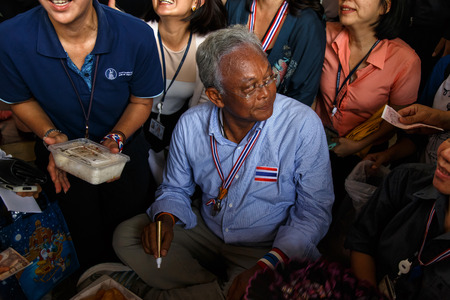 BANGKOK - APRIL 3 2014: Leader Suthep takes money from supporters and signs autograph for protesters near Rama 8 Bridge in Bangkok, Thailand Stock Photo - 27171606