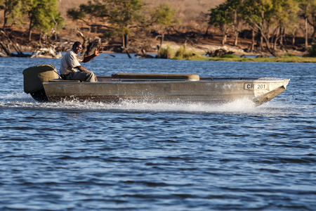 chobe: Boat in Chobe River, Chobe National Park, Botswana, Africa Editorial