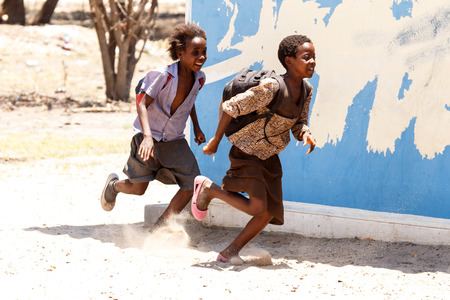 KATIMA MULILO, NAMIBIA - OCTOBER 16 2013: Kids playing during a year of drought in the North Eastern town of Katima Mulilo in Namibia, Africa