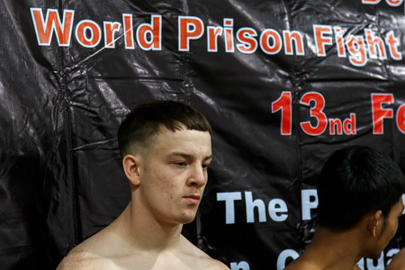 part prison: THAILAND - FEBUARY 12 2014: John Nofer takes part in press conference for the upcoming Prison Fight round 6 competition in Khlong Phai Prison, Thailand