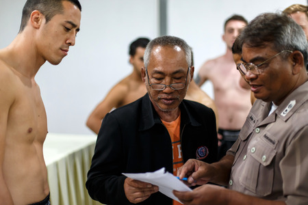 part prison: THAILAND - FEBUARY 12 2014: International and Thai fighters take part in press conference for the upcoming Prison Fight round 6 competition in Khlong Phai Prison, Thailand