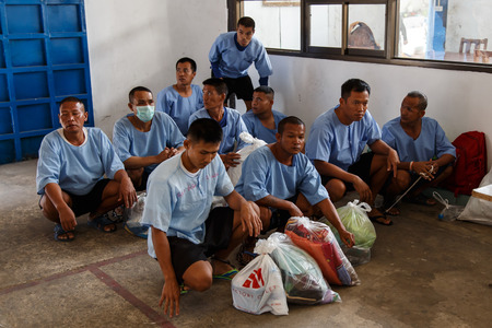 inmates: THAILAND - FEBUARY 12 2014: New Thai prisoners  inmates arrive at Khlong Phai Prison, Thailand