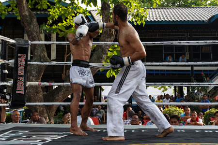 inmates: THAILAND - FEBUARY 13 2014: Prison fight  muay thai competition between international fighters and inmates within the walls of KhlongPai Prison, Thailand