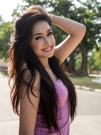 model posing: Beautiful Dark Haired Thai Asian Model Poses in Outdoor Natural Setting