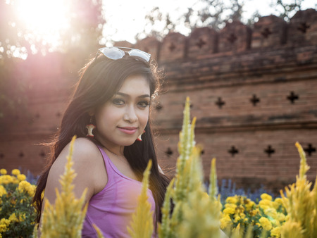 dark haired: Beautiful Dark Haired Thai Asian Model Poses in Outdoor Natural Setting