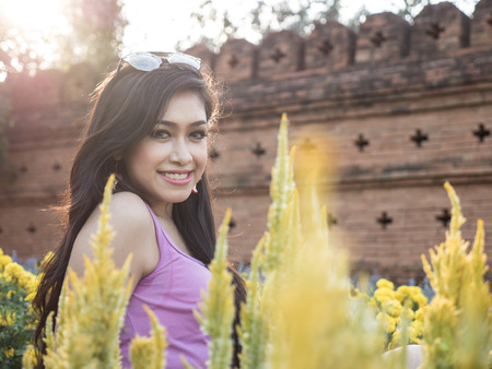 natural setting: Beautiful Dark Haired Thai Asian Model Poses in Outdoor Natural Setting