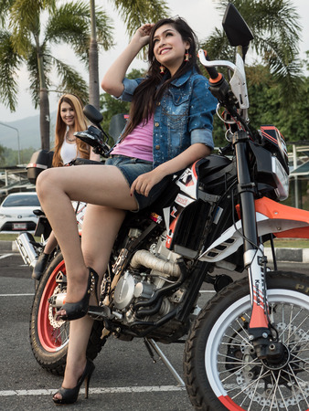 dual: Pretty Girl With Supermoto Dual Sport Motorbike