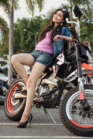 dual: Pretty Girl With Supermoto Dual Sport Motorbike