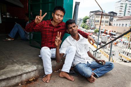 recorded: YANGON, MYANMAR - JUNE 12 2015: Local men on one of the hottest recorded days before monsoon season in Yangon, Myanmar. Editorial