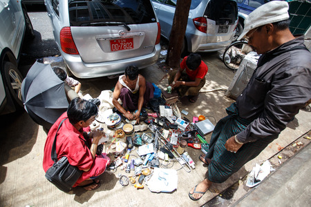 secondhand: YANGON, MYANMAR - JUNE 12 2015: Secondhand electrical components for sale on one of the hottest recorded days before monsoon season in Yangon, Myanmar.