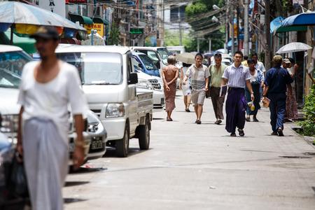 hottest: YANGON, MYANMAR - JUNE 12 2015: Local people walking on one of the hottest recorded days before monsoon season in Yangon, Myanmar. Editorial