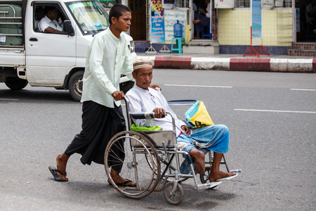 recorded: YANGON, MYANMAR - JUNE 12 2015: Disabled man on one of the hottest recorded days before monsoon season in Yangon, Myanmar.