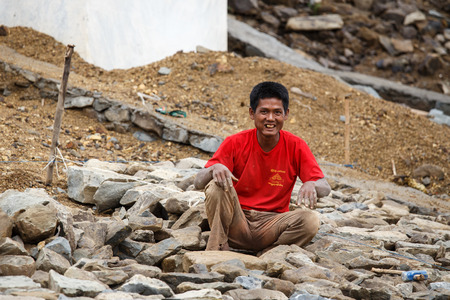 slave labor: FALAM, MYANMAR - JUNE 17 2015: Local people work hard on construction at Laiva Dam in Chin State, Western Myanmar (Burma) Editorial