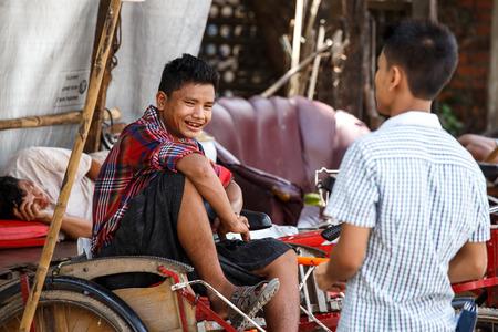 trishaw: YANGON, MYANMAR - JUNE 12 2015: Trishaw drivers on one of the hottest recorded days before monsoon season in Yangon, Myanmar.
