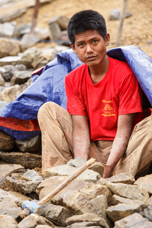 western state: FALAM, MYANMAR - JUNE 17 2015: Local people work hard on construction at Laiva Dam in Chin State, Western Myanmar (Burma) Editorial