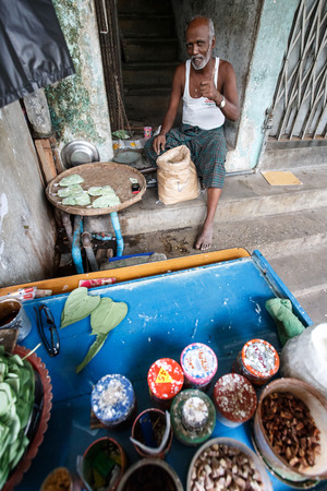 recorded: YANGON, MYANMAR - JUNE 12 2015: Local man making sweet snack on one of the hottest recorded days before monsoon season in Yangon, Myanmar. Editorial