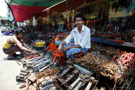 hottest: YANGON, MYANMAR - JUNE 12 2015: Metal tool shop on one of the hottest recorded days before monsoon season in Yangon, Myanmar.