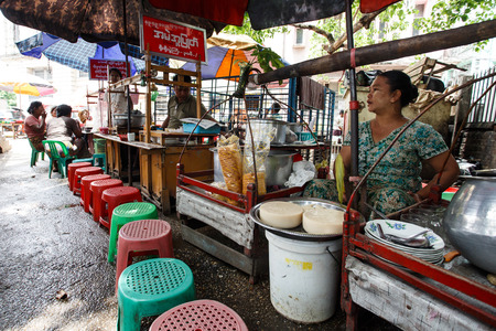 recorded: YANGON, MYANMAR - JUNE 12 2015: Local food market on one of the hottest recorded days before monsoon season in Yangon, Myanmar.
