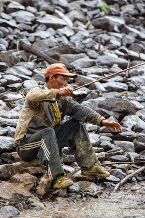 recently: FALAM, MYANMAR - JUNE 17 2015: Fisherman at the start of the monsoon season in the recently opened to tourists Chin State region of Western Myanmar (Burma)