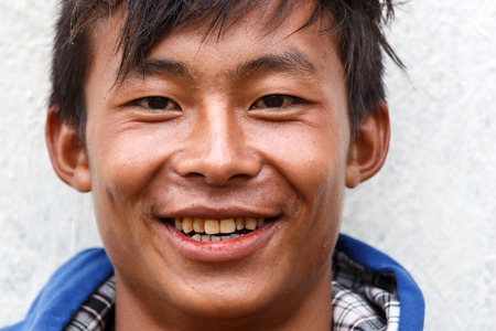 western state: FALAM, MYANMAR - JUNE 17 2015: Local boy smiling at the start of the monsoon season in the recently opened to tourists Chin State region of Western Myanmar (Burma)