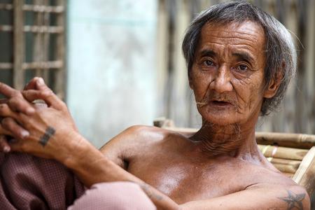street wise: YANGON, MYANMAR - JUNE 12 2015: on one of the hottest recorded days before monsoon season in Yangon, Myanmar. Editorial