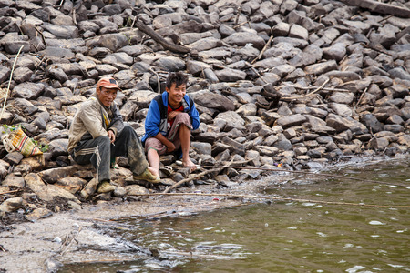 western state: FALAM, MYANMAR - JUNE 17 2015: Fishermen at the start of the monsoon season in the recently opened to tourists Chin State region of Western Myanmar (Burma) Editorial