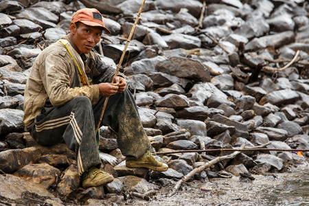 western state: FALAM, MYANMAR - JUNE 17 2015: Fisherman at the start of the monsoon season in the recently opened to tourists Chin State region of Western Myanmar (Burma)
