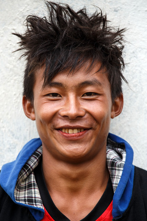 recently: FALAM, MYANMAR - JUNE 17 2015: Local boy smiling at the start of the monsoon season in the recently opened to tourists Chin State region of Western Myanmar (Burma)