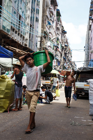 recorded: YANGON, MYANMAR - JUNE 12 2015: City center on one of the hottest recorded days before monsoon season in Yangon, Myanmar.