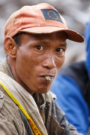 western state: FALAM, MYANMAR - JUNE 17 2015: Local man smoking burmese cigar (cheroot) at the start of the monsoon season in the recently opened to tourists Chin State region of Western Myanmar (Burma) Editorial