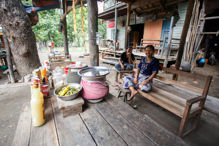 chins: CHIN STATE, MYANMAR - JUNE 16 2015: Two ladies sit in a village in the recently opened to foreigners area of Chin State - western Myanmar (Burma)